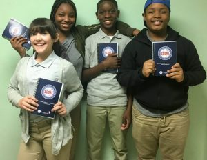 8th grade students with their SCORE journals